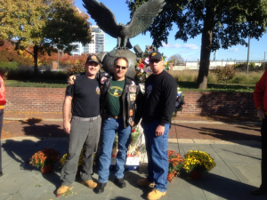 Shawn Gallagher (L) poses with fellow Marines Richard Watson (C) and Tim McVay (R)